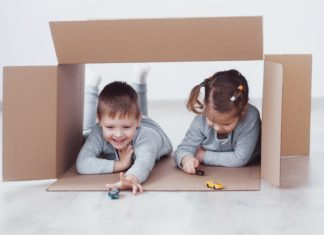 Kids Playing With Giant Cardboard Box Cars