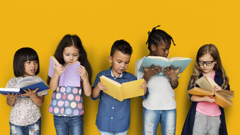 Kids Reading Books Standing Yellow Background