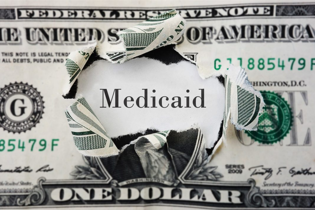 Medicaid Dollar Torn Hole