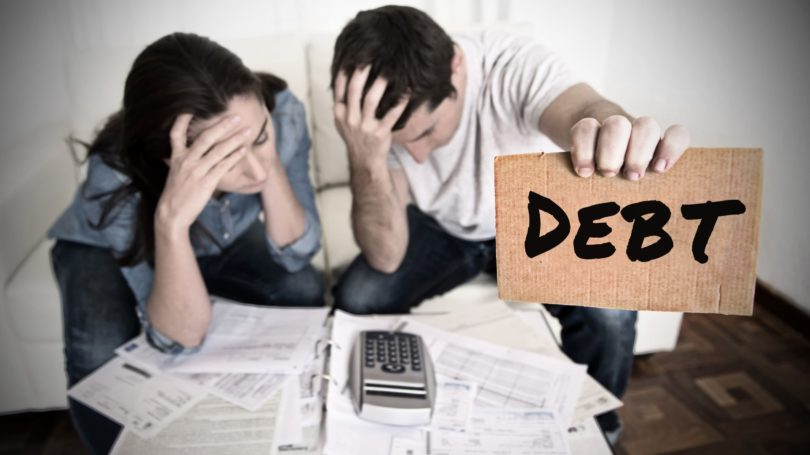 Couple Drowning In Debt Bills Invoices