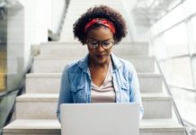 African American College Student Studying Online Laptop Campus