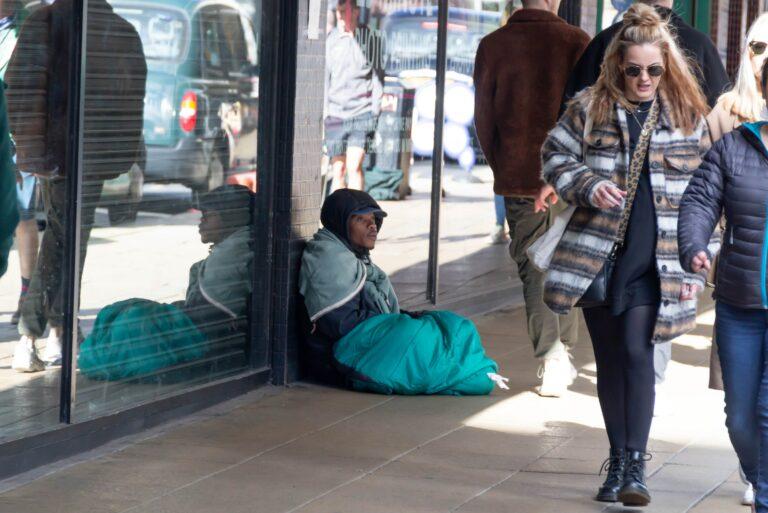 Homeless Man Sitting Busy Sidewalk