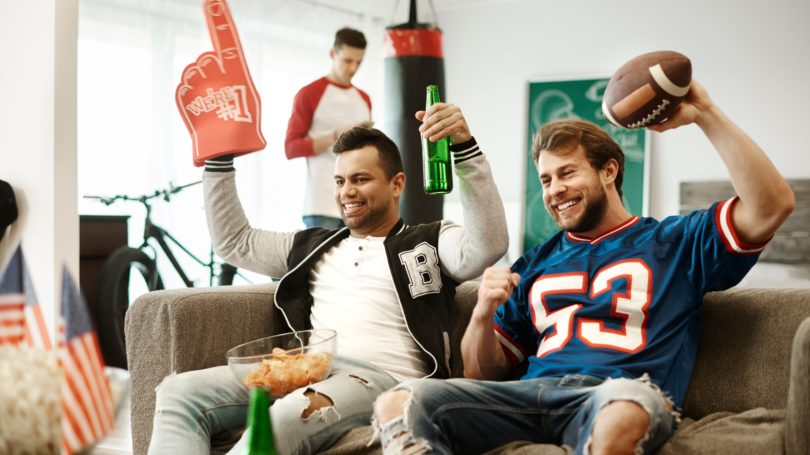 Guys Watching Football Tv Couch Cheering Fans