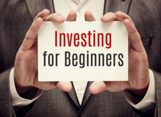 Investing For Beginners Man In Suit Holding Card