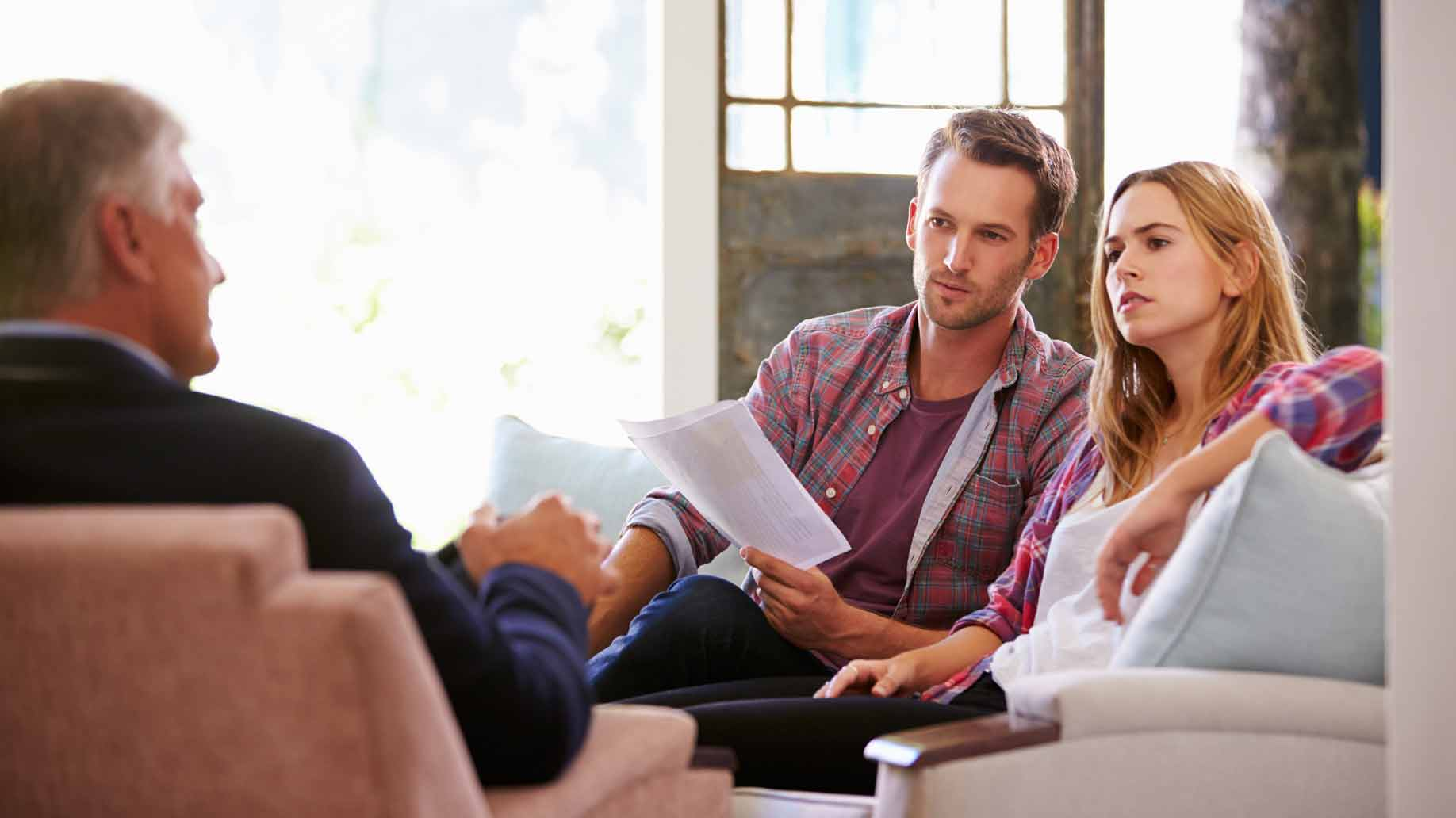 financial advisor meets with couple at home
