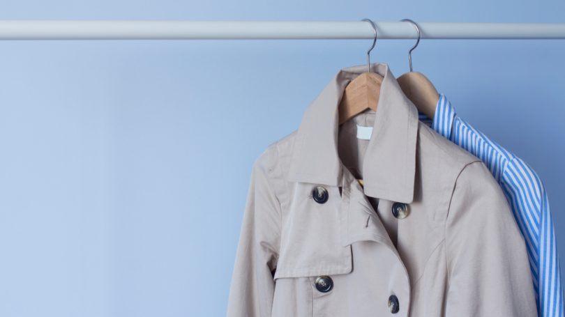 Trench Coat White Shirt With Blue Stripes Hanging On Rack