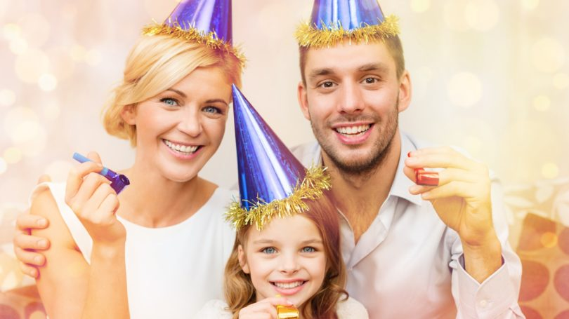 Family Dressed Up For New Year Party Celebration