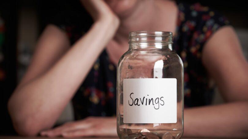 Empty Savings Jar Depressed Woman