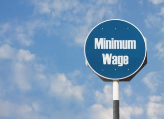 Minimum Wage Signage Clouds Sky