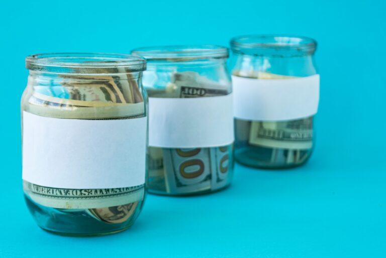 Three Glass Jars Containing Money