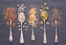 Various Seeds On Spoons Sesame Flax Sunflower Pine