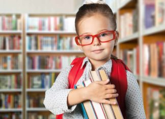 little girl in the school library