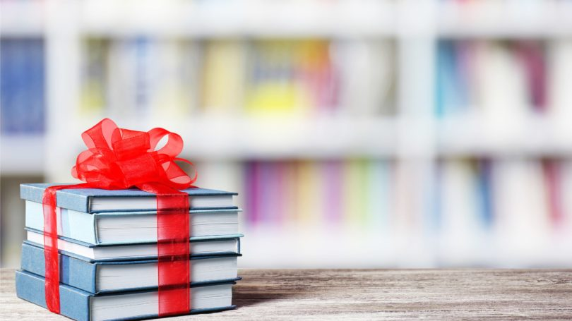 Stack Of Books With Ribbon Gift