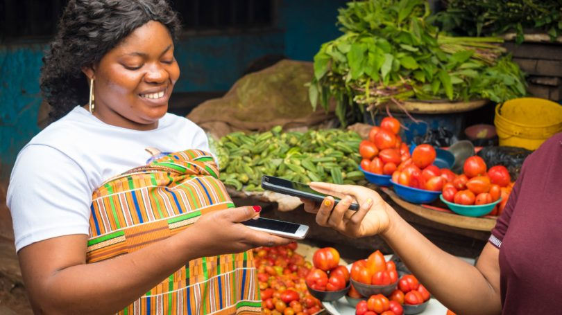 African America Woman Selling Fresh Produce Receiving Payment Mobile Contactless