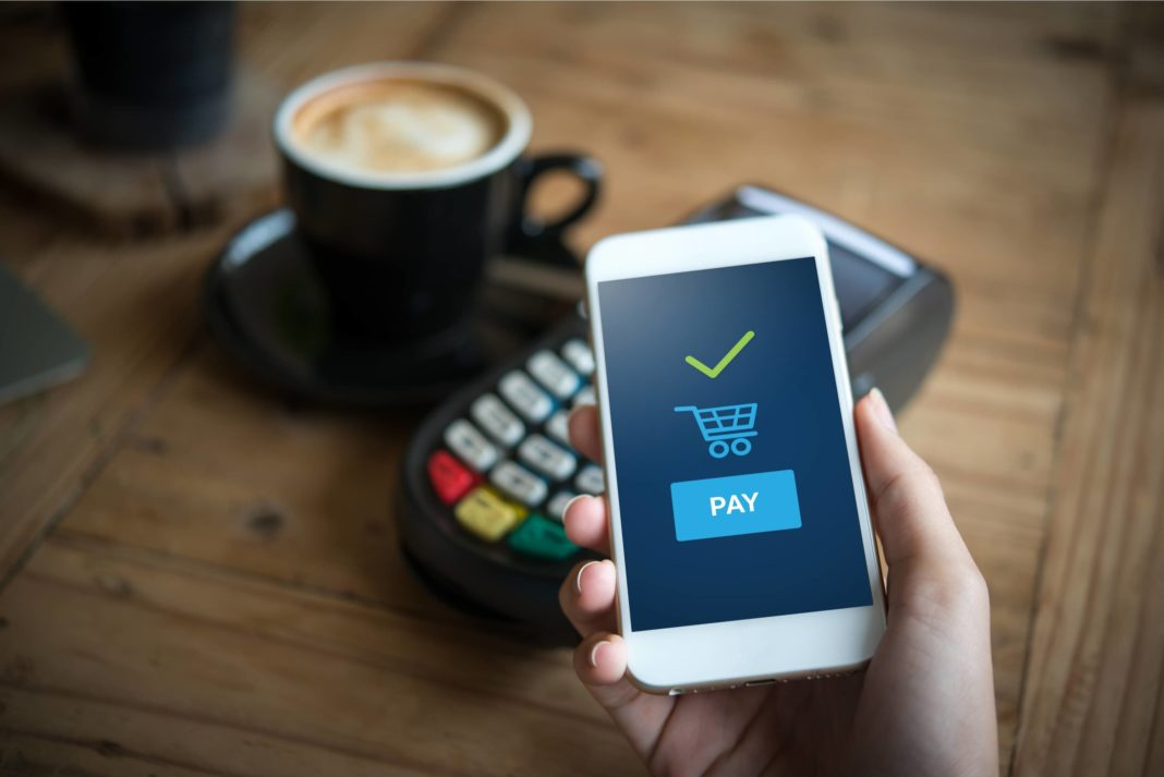 Paying For Coffee With Mobile Contactless Payment App Phone