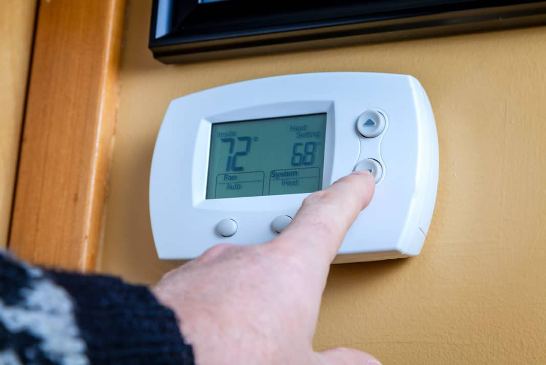 Thermostat Being Adjusted Down