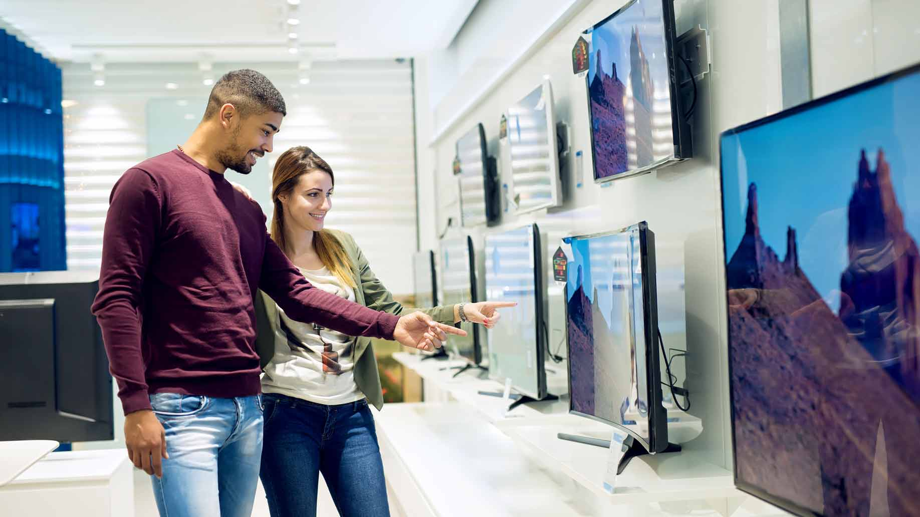 couple shopping for new flat screen television