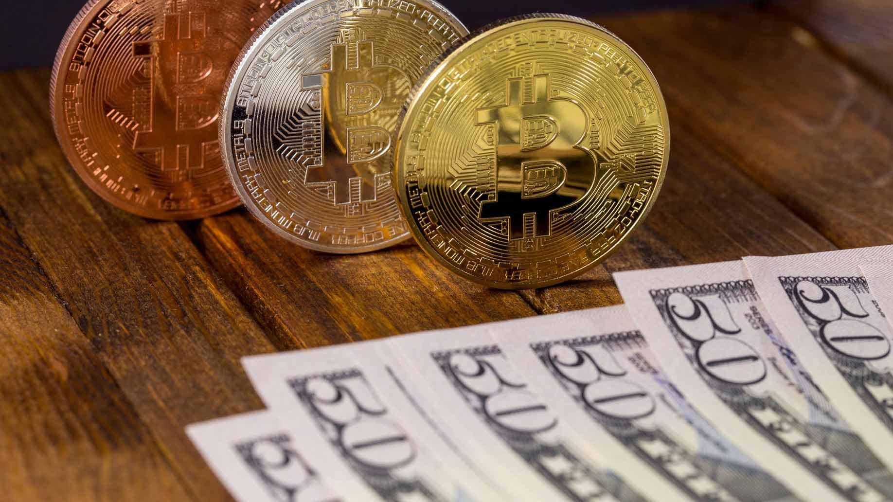 bitcoins and 50 dollar bills