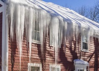 house with ice dam icicles