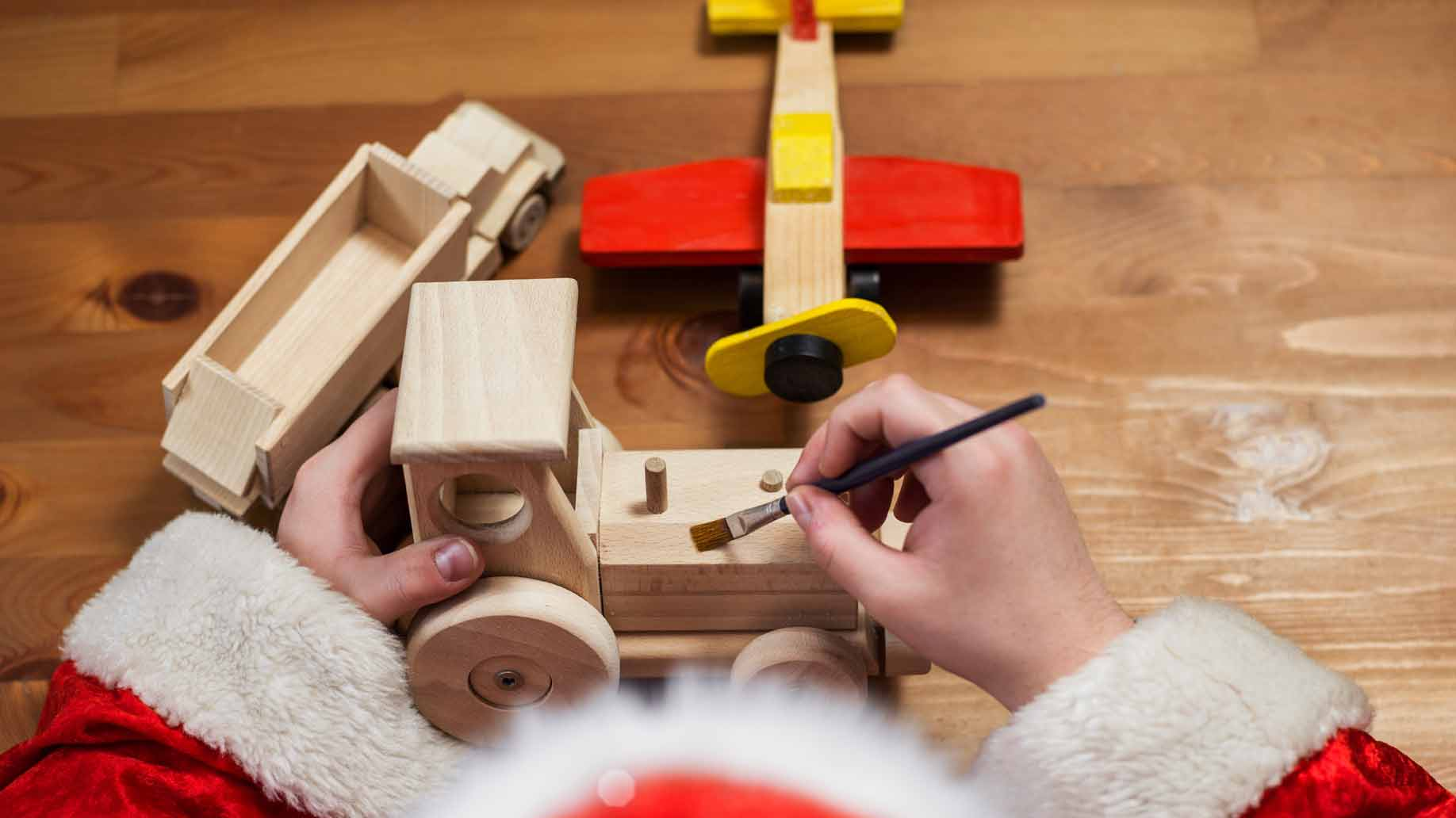 santa claus making wooden toys