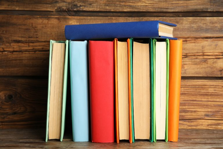 Books Lined Up Colorful Hardcover Design
