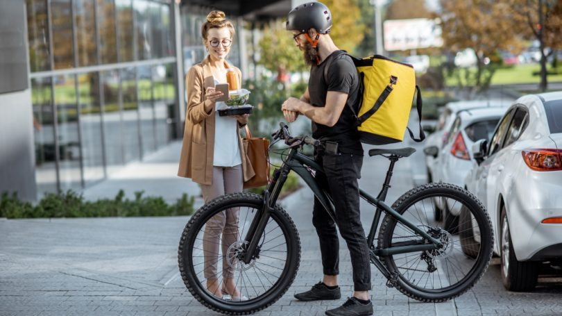 Bike Courier Delivering Fresh Food In Insulated Thermal Backpack