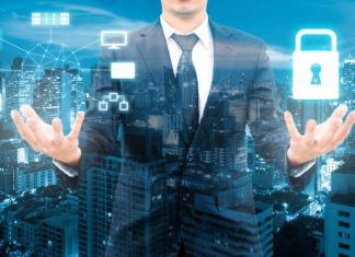 double exposure of a business man with illuminated computer icons
