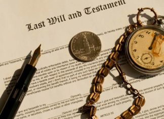 last will and testament on desk with pen and pocket watch