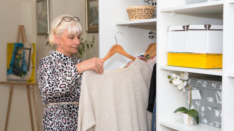 Declutter Closet Woman Sorting Clothes