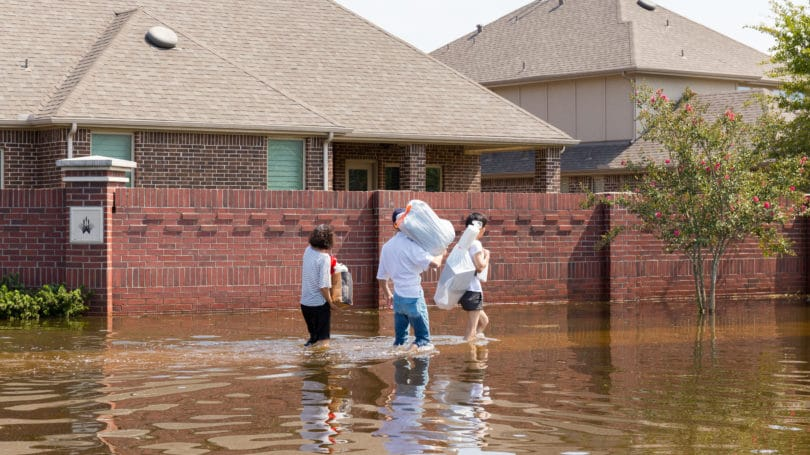 Residents Walk High Waters After Hurricane