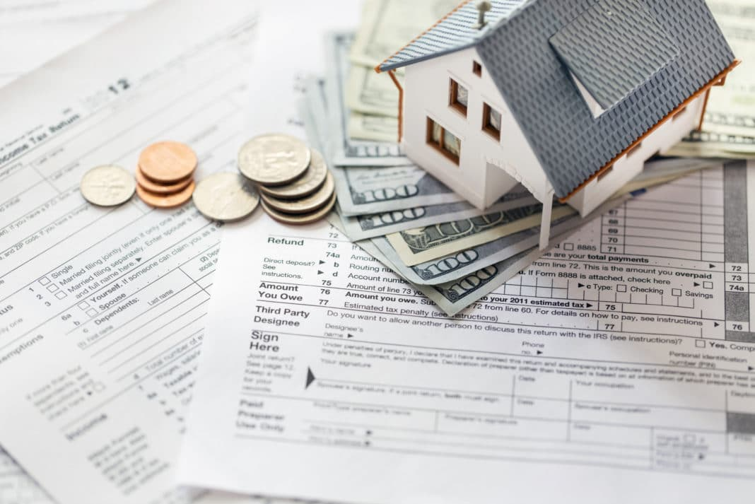 How to Calculate Real Estate Property Taxes & Appeal Your Assessment