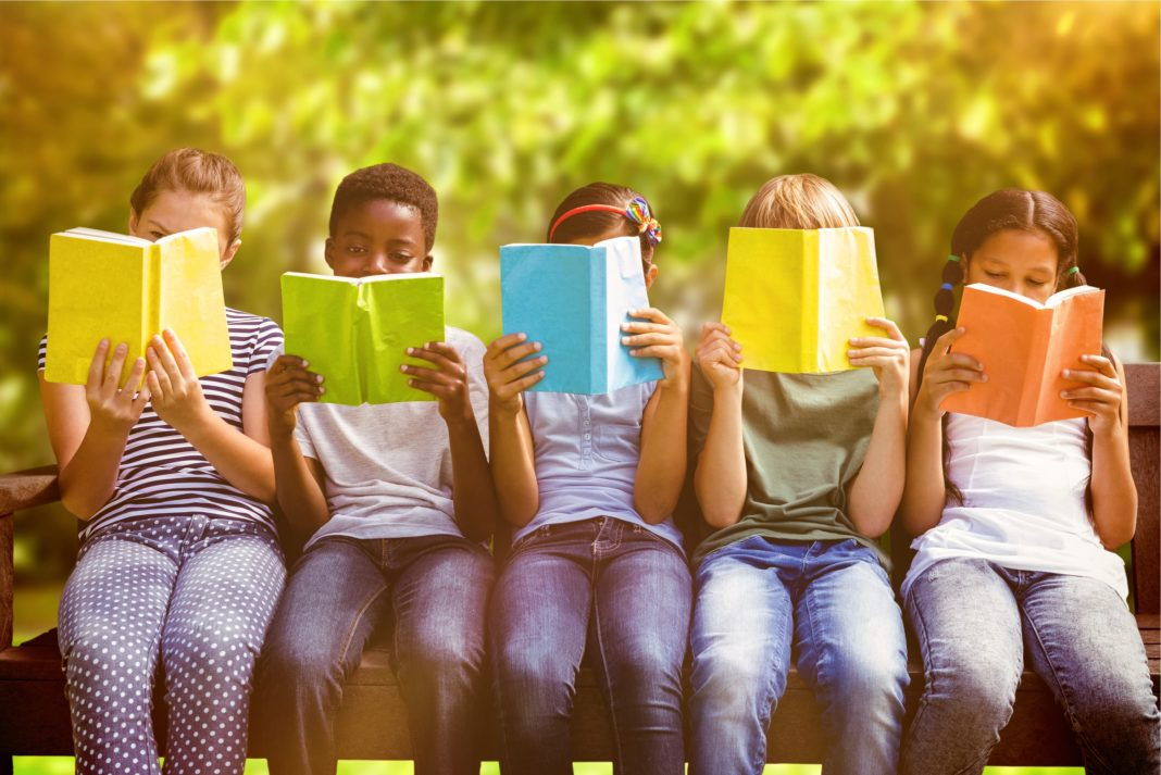 Children Reading Colorful Denim Outdoors