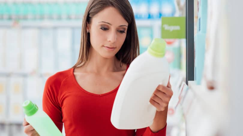 Comparing Prices Generic Name Brand Detergent Woman Store Aisle