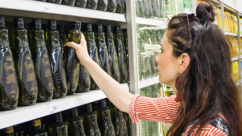 Generic Vs Name Brand Olive Oil Store Aisle Woman Shopping Supermarket Grocery