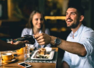 Man Paying Restaurant Meal With Credit Card