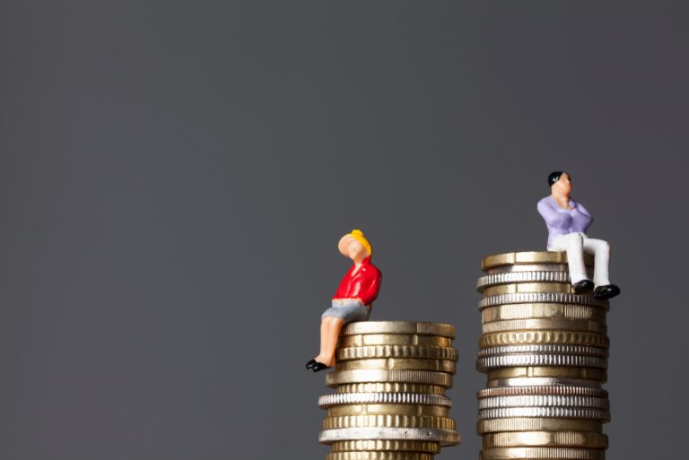 Man Woman Pile Of Coins Gender Wage Gap