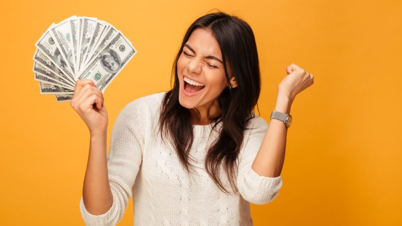 Woman Happy Holding Cash Money Excited