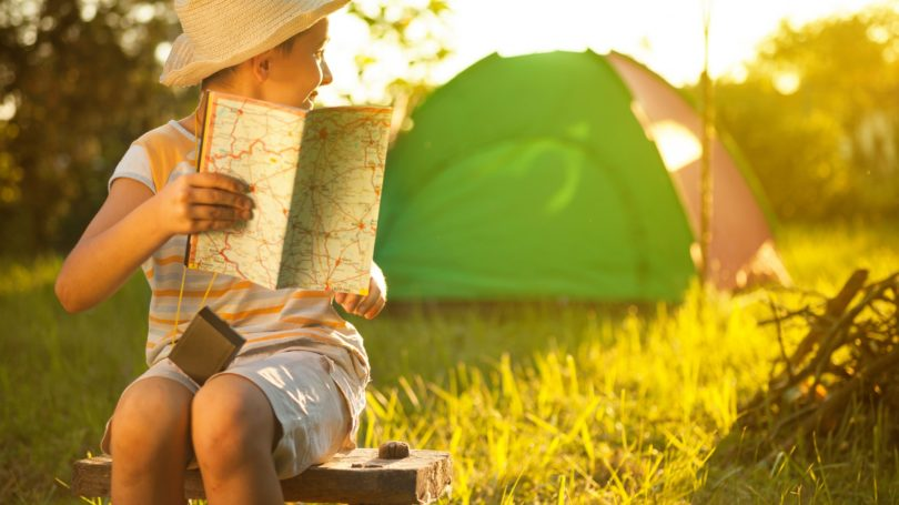 Toddler Boy Camping Tent Looking At Map
