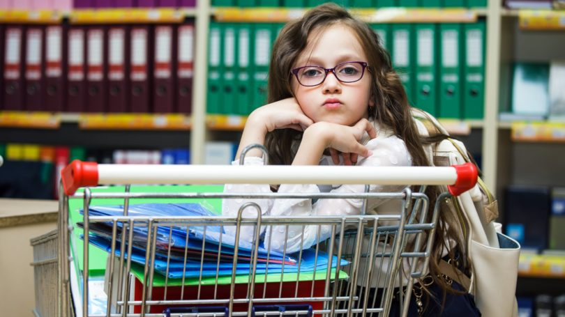 Little Girl Buying Stationery School Supplies