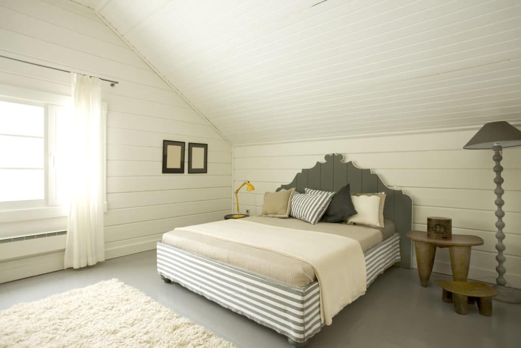 Cozy White Gray Bedroom With Pillows Lamps Rug