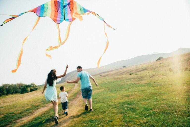 Family Flying Kite Outdoors
