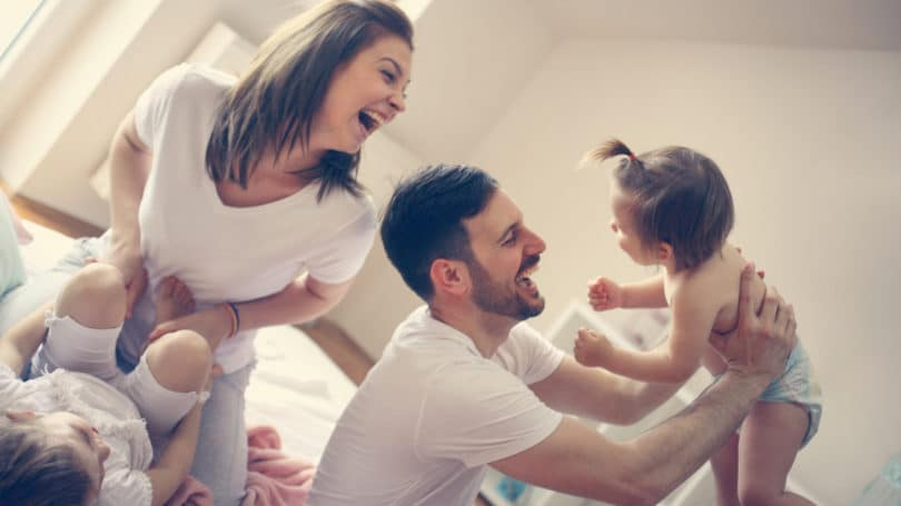Family Playing Rough Housing Joy Laughter