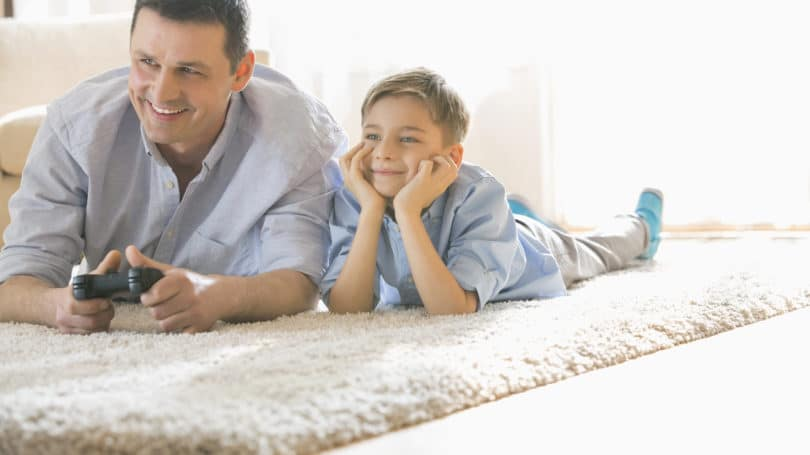 Father Son Playing Video Games Living Room
