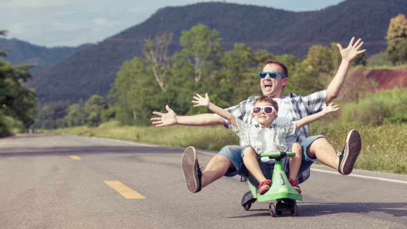 Father Son Scooting Sunglasses Outdoors Street