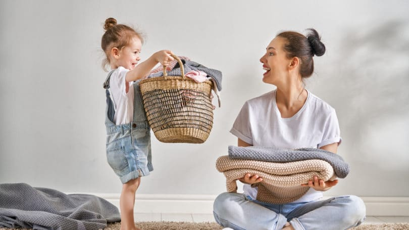 Mom Daughter Doing Laundry Together