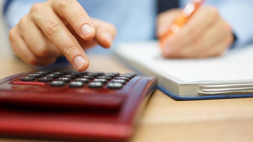 Calculating Man Pen Notebook Table