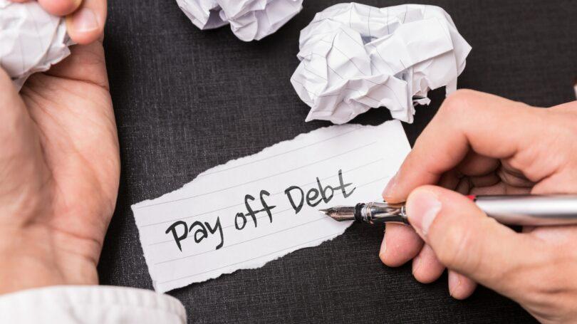 Pay Off Debt Pen Paper Crumbled Balls