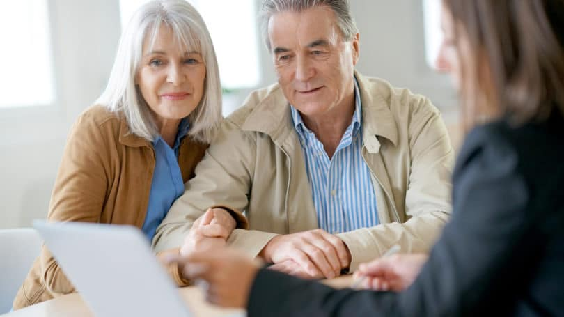 Elderly Couple Financial Planner Meeting