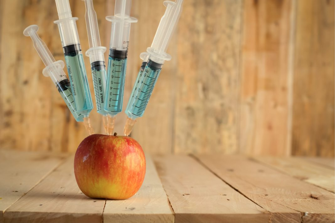 Gmo Apple Syringe Wooden Table