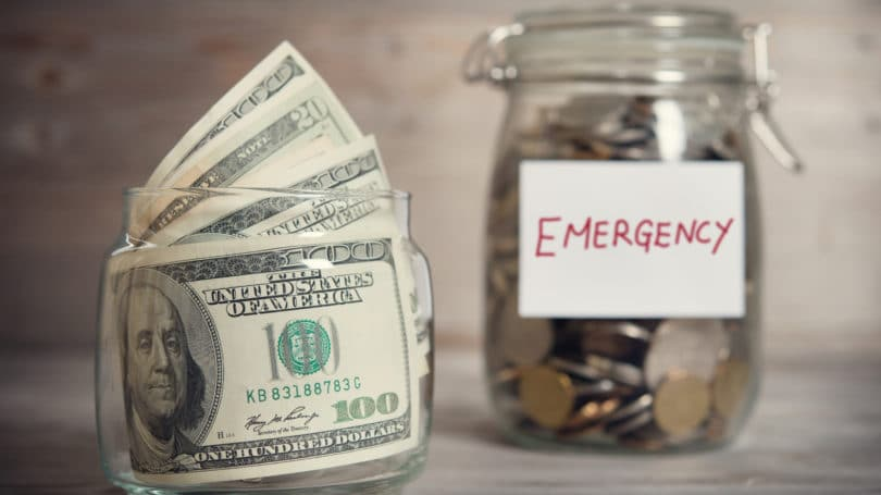 Emergency Fund Jar Of Coins Cash Bills